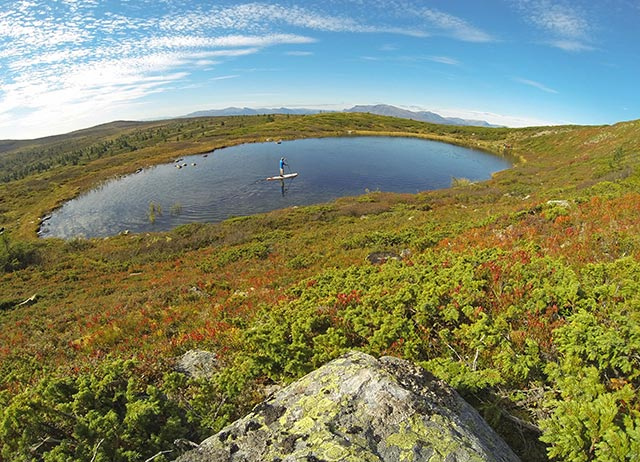 Knut Sorby: SUPing on a small lake up in the Gol mountains in Norway. The lake was actually only 100 meters long, but I just thought it would be a cool photo. Also got some strange looks from people I met while carrying my board along the path across the mountain. Photo taken with GoPro on Time Lapse.