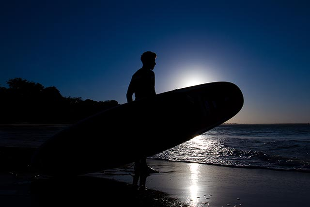 Marcelino Mota: Rafael about to head out on a sunset sup session.