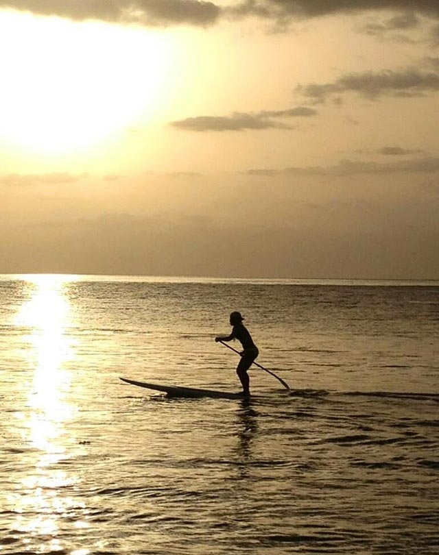 Maytte Rivera: Anais standup paddling to the sunset in Cabo Rojo, Puerto Rico