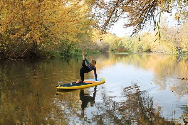 "Natasha Palmer: Fall on the Boise River is gorgeous. Natasha doing some SUP yoga on the Glide Lotus board. All I could think was ""Don't fall in!!"" This part of the river is my favorite with all the trees and the quiet nature of the area."