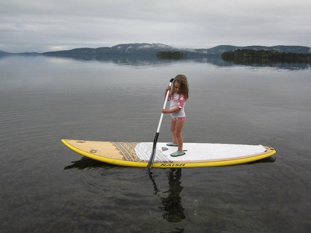 Rob Paterson: Starting Early! My daughter Emily in mid-winter on Wallis Lake, Australia, having a go because she loves the water!