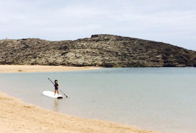 Thaira Gomez: Boy meets SUP world! Behind every young child who believes in himself is a parent who believed first. Mauricio André Lugo at Puerto Nuevo Beach, Vega Baja, Puerto Rico. 4 yrs old.