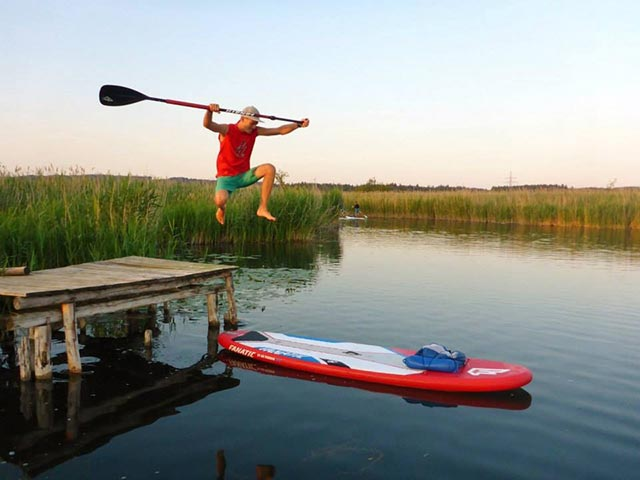 Valentin Illichmann: Jumping from the pier onto my Fanatic sup board before my sunset sup session down the river Würm in Bavaria.