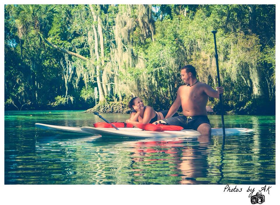 This is our first photo after my now husband proposed. We were paddle boarding, with friends, at three sisters springs, in Crystal River, Fl.