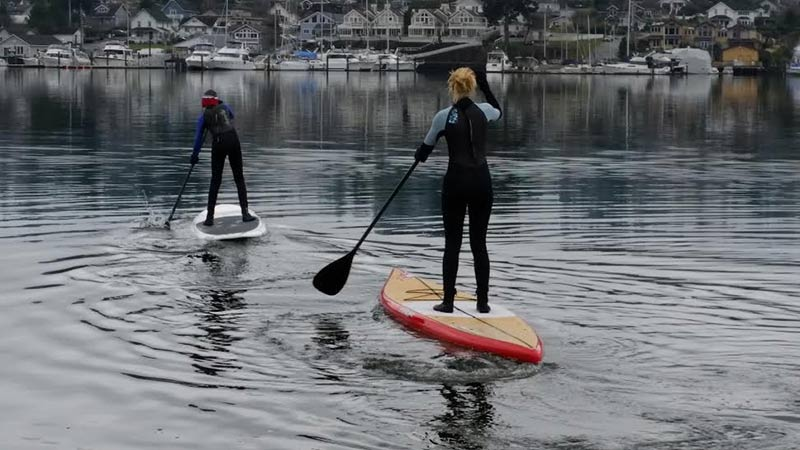 Drew Kellerman: Celebrating the New Year in true Pacific Northwest fashion, Chase and Malia Kellerman lead their Dad on a tranquil, early January paddle across Puget Sound in Gig Harbor, WA.