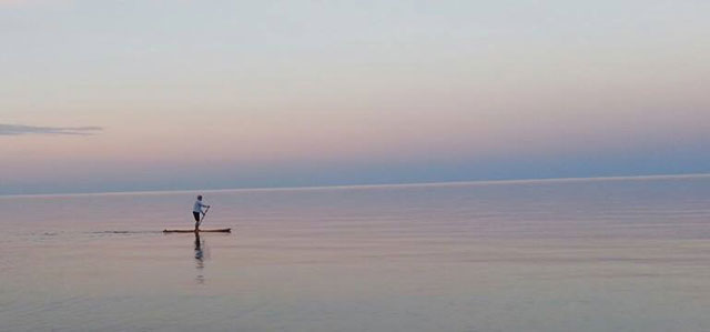 "Kathryn Lassila: A beautiful day for paddling on Lake Superior near Gay, Michigan. Kathryn Lassila and her family stay at her husband's family cabin in Hermit's Cove. Such a calm day on ""the big lake"" is kind of a rarity."