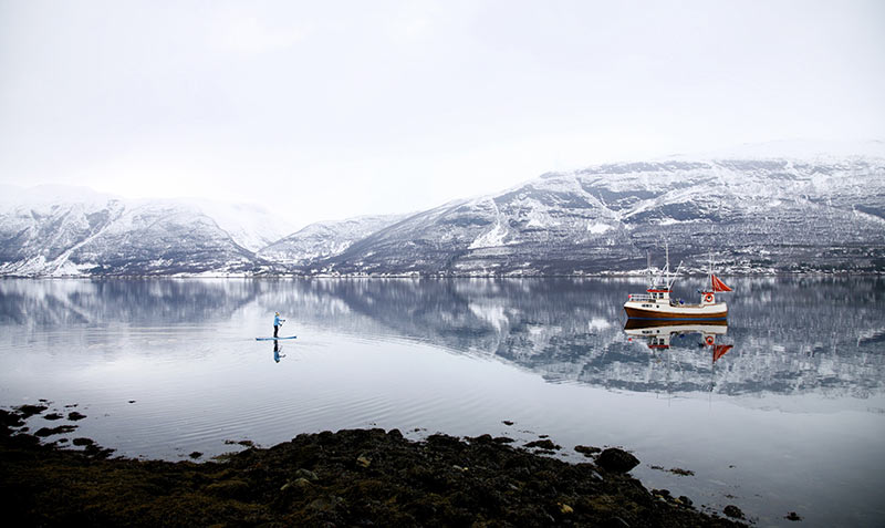 Sanna Juutilainen: Misty morning moment in Storfjord, Northern Norway, in April 2015. Sanna Juutilainen is SUPing all year round and anywhere she goes. Picture by Taneli Brander.