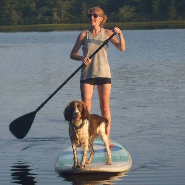 Sheena Walsh: sup with my first mate! In the pine barrens of Southern New Jersey, paddleboarding on a peaceful quite lake in the middle of nowhere.