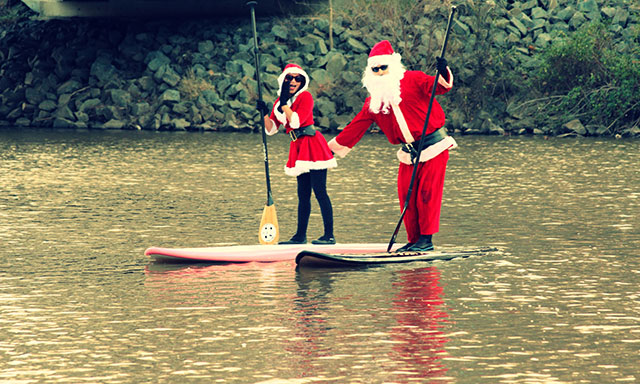 "Stephen Weisweaver and Velvet Siervo: ""Santa Baby, that's not your SUP Paddle"". . Velvet Siervo and Stephen Weisweaver catch SUPing Santa working his way toward the naughty list at Bull Run Marina, VA - Nov 28, 2014."