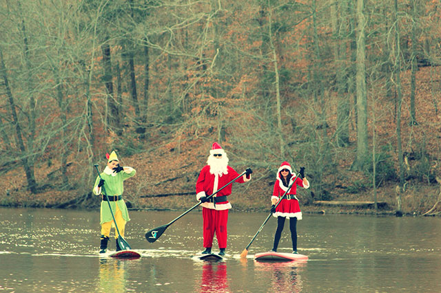 "Stephen Weisweaver: ""A family that ""Santa SUP's"" together, stays together""...Velvet Siervo, Stephen and SA Weisweaver at Bull Run Marina, VA - Nov 28, 2014."