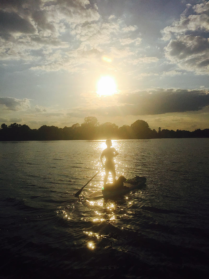 Carlos Boyd: How we do it in South Lousiana. Allison Smith and Finnegan paddling the beautiful LSU lakes. Just a girl and her dog gliding thru liquid sunshine!