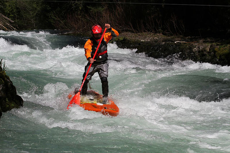 Corran Addison running Maytag on the White Salmon in Washington on his Firestorm SUP