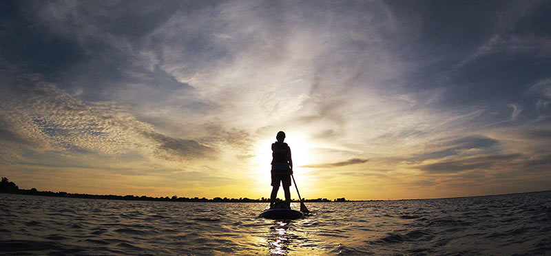 Jesslynn Cody Armstrong: As we flow to our LIGHT, We surrender to our Shadows..., was Lisa Gill Veach's inspired response to Jesslynn paddling her SUP towards the mid-May sunset for the first time on Lake Hefner (Oklahoma).