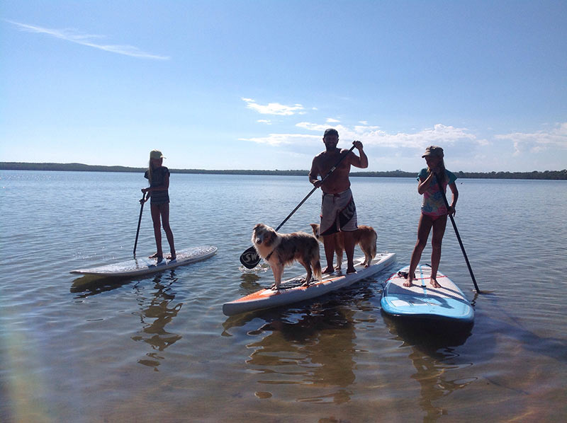 Mathew wilson: me, my two daughters and my two puppies on Lake Weyba, Sunshine Coast QLD. Trying out our new Christmas presents. It appears my two dogs suffer separation anxiety.