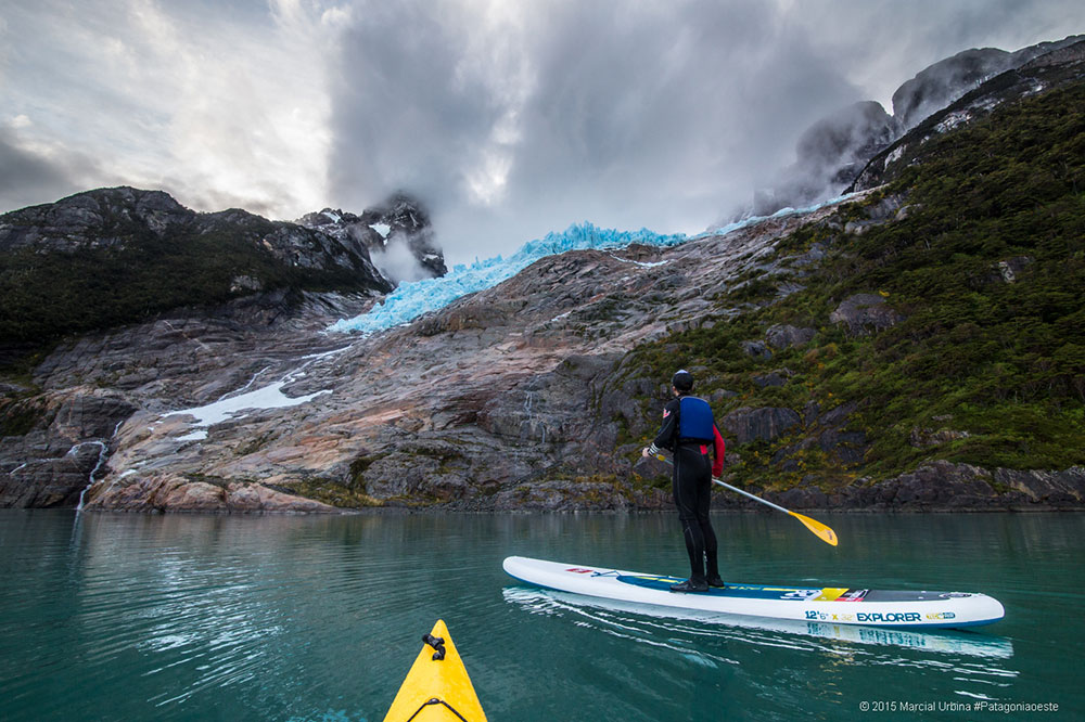 Christopher Theobald: We organised a risky (due to the dangerous and unpredictable weather conditions in Patagonia) an expedition to get pics infront of some stunning glaciers in Bernard O Higgins National park, Patagonia, Chile. We caught a boat, took kayaks and paddled our way out to 2 famous ice rock faces, with the epic photographer Marcial Urbina shooting photos under an umbrella protecting his prized cameras and paddling at the same time we managed to get this shot. The thrill of paddling in this magical place with nobody else around us is something you can never forget.
