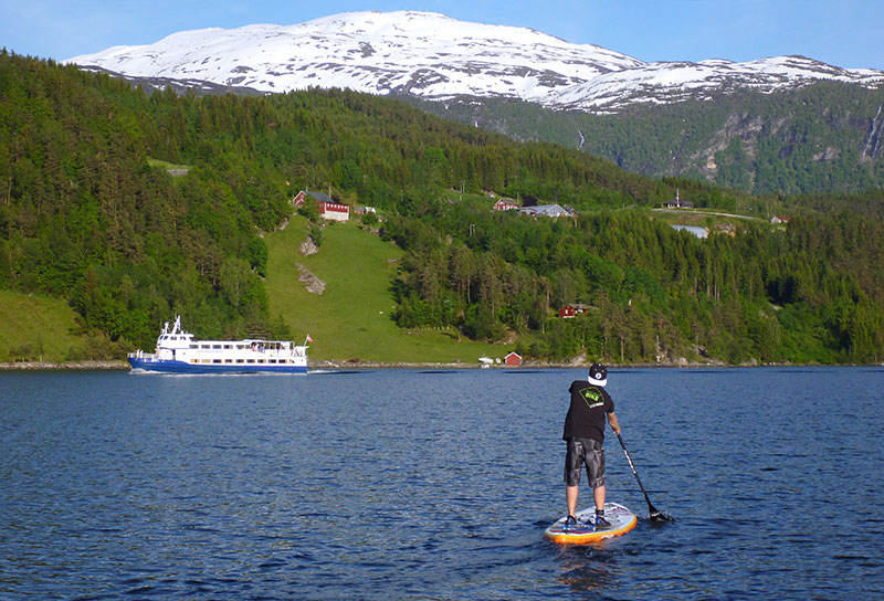 Knut Sörby: Summer SUPing in Norway with my nephew on Ulvikafjorden in the western part of Norway. The local ferry Hardangerfjord in the background.