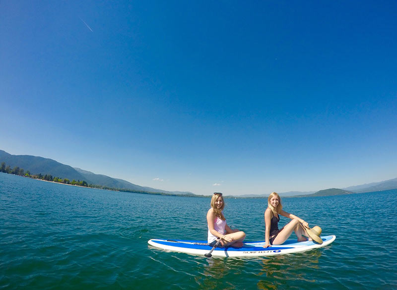 Laura Gay: Visited an old college roommate in Sandpoint Idaho and introduced her to paddleboarding. Simply taking a break for a cute picture on this gorgeous lake!