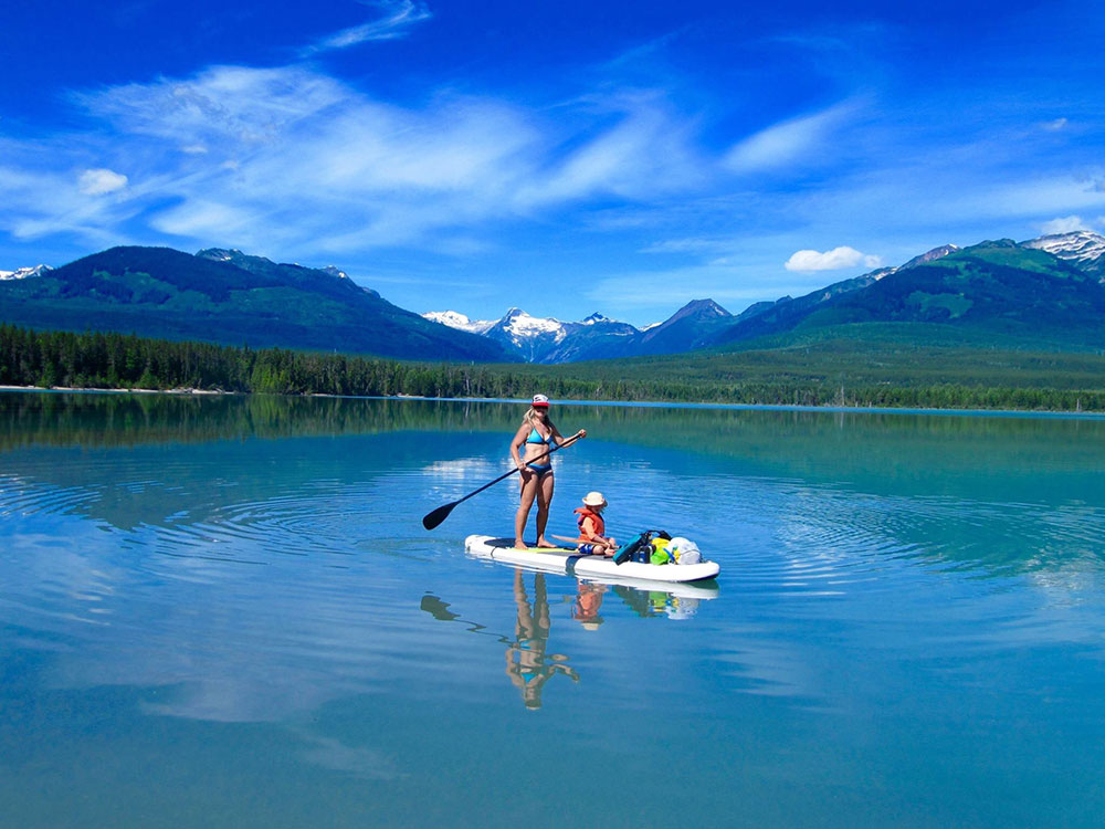 Lonna sheen: SUPing through blue skies, snowy peeks up in Terrace, BC on the Beautiful, pristine, glacial fed Kalum lake!