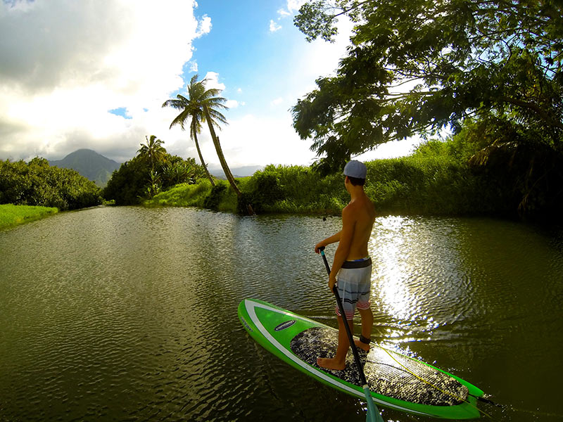 Tom Paterson, aged 12, stand up paddling the Hanalei River in Kaua'i. Absolute paradise and perfection!
