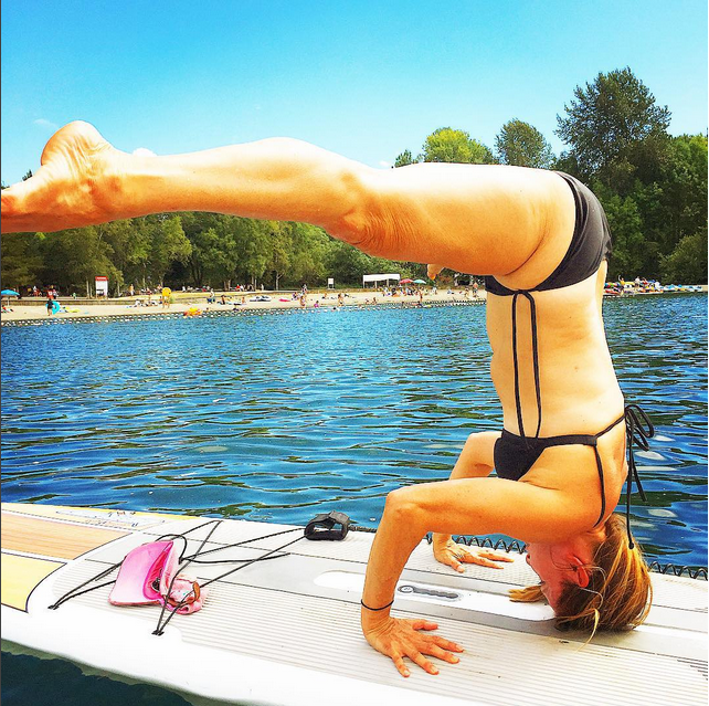 reneeryanyoga Been working on my sup yoga this summer, going upside down on the water keeps you focused on the present! #tripodheadstand#paddleboardyoga #SUPyoga #balance#focus #lake #water #yoga #yogagirl#yogateacher #yogaiseverywhere