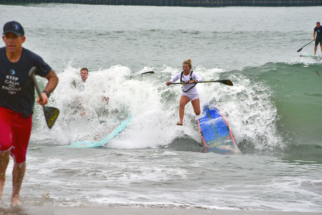 Shae Foudy and Fiona Wylde duke it out in the surf ! What a race! Shae Foudy and Fiona Wylde took it right into the surf line in an all-out battle for first place in the women's division at the Paddlefest 2016 race. Fiona took the win with Shae not far behind - and both of them had quite a ride! -Glenn Dubock