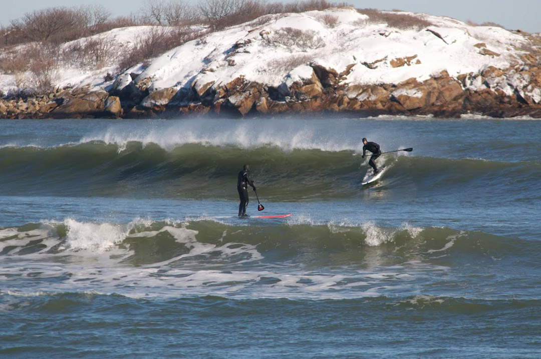 Travis Hayes winter sup surf in New England