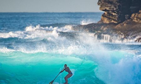 Charlotte Piho Riding big waves on her standup paddleboard