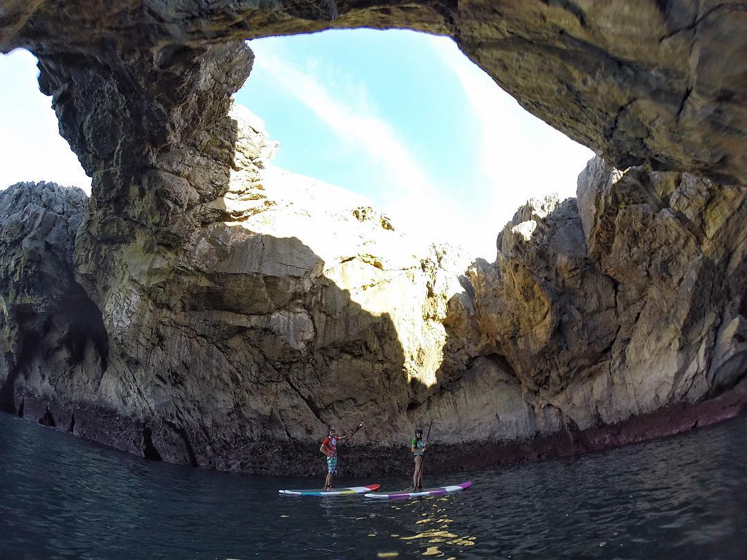 Exploring some caves by standup paddleboard in Llanes, Spain