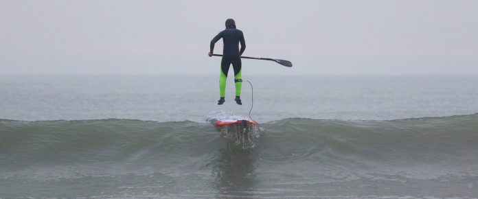 Patrice Guenole photo sup surfer jump